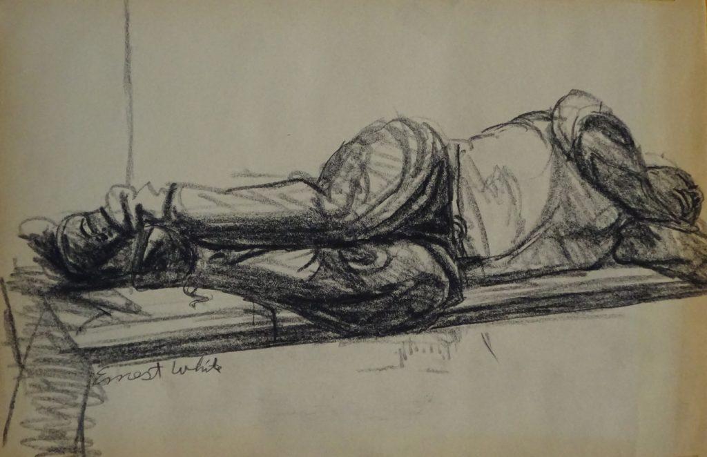 Drawing of man lying in subway