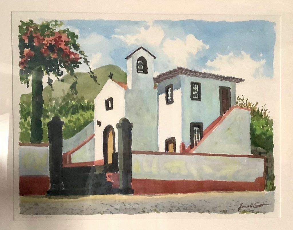 hite church behind a white wall